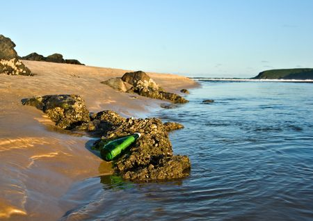 castaway: an sos message in a bottle at the beach
