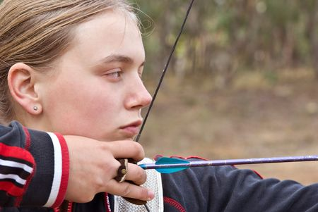 great image of a teenage girl doing archery Stock Photo - 3375268