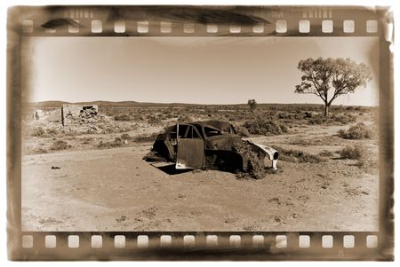 rusting: an old car rusts away in the hot australian desert Stock Photo
