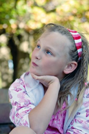 wistful: soft and dreamy focus image of a young girl wistful and waiting Stock Photo