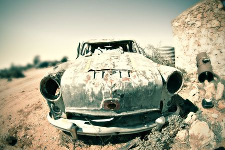 jalopy: cross processed image of an old car in the desert