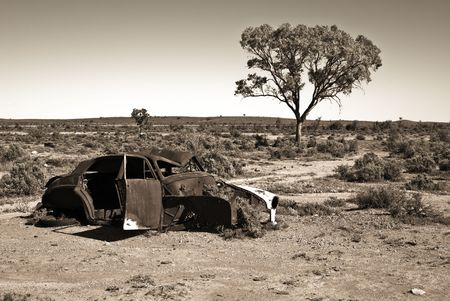 rusting: great image of an old car rusting away in the desert Stock Photo