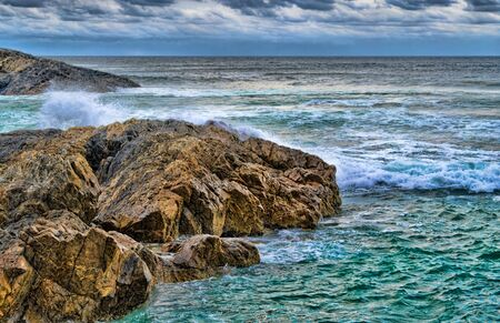 fine art image of strong and resilient rocks at the sea
