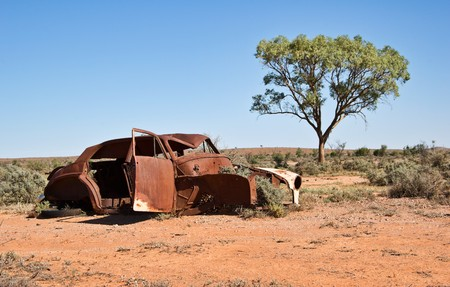 jalopy: great image of an old car rusting away in the desert Stock Photo