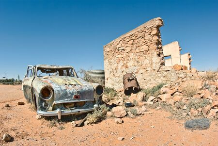 great image of an old car rusting away in the desert Stock Photo - 3953533