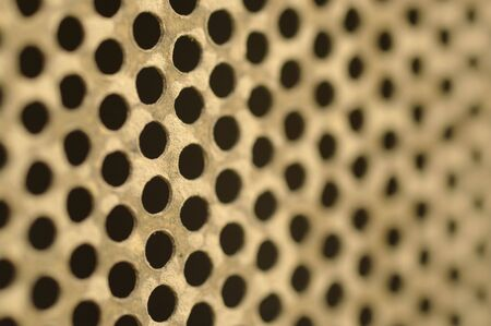 old brass metal mesh holes background texture photo