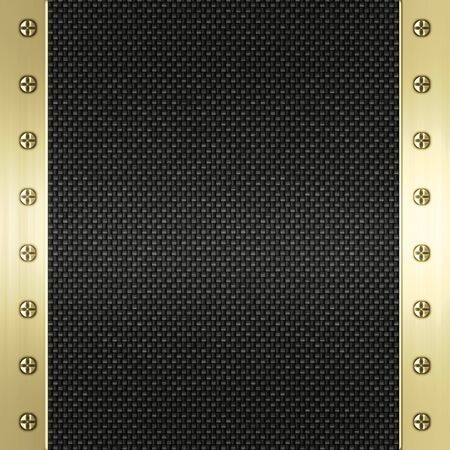 image of carbon fibre inlaid in gold metal frame photo