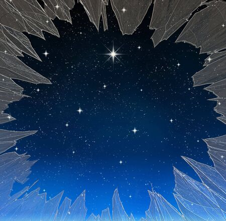 a single bright wishing star stands out from all the rest through a smashed window photo