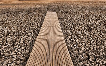 great image of a pontoon or jetty on a dry cracked lake bed Stock Photo - 5541928