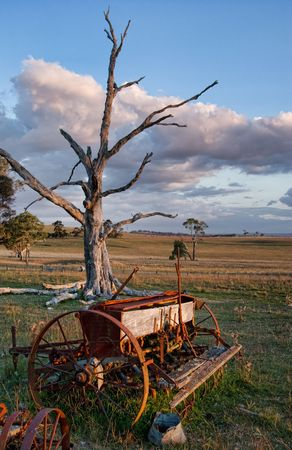 old farm machinery and equipment in the field photo