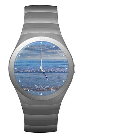 five o'clock: five oclock finish time with wristwatch with beach face Stock Photo