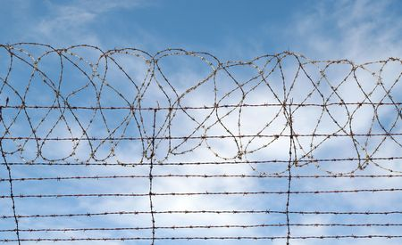 gaol: great image of a barbed wire jail or gaol fence Stock Photo