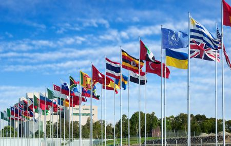 flagpoles: flags of the world flapping in the wind