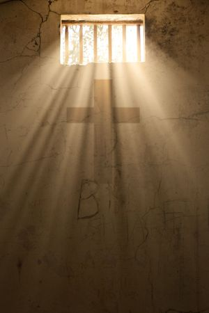 prison bars: light of freedom or hope with cross of christ