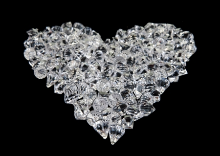 great love heart made of diamonds on black background photo