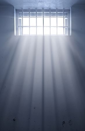 imprison: a cold prison cell with sunshine through window