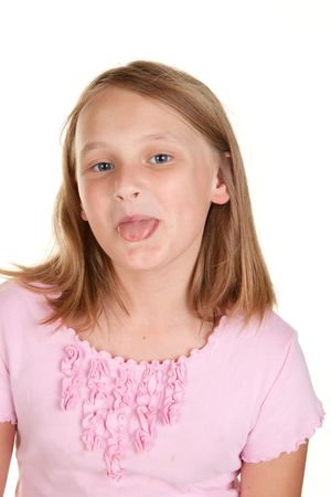 mischevious: young girl poking out tongue  isolated on white
