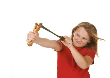 mischevious: naughty little girl with a slingshot on white Stock Photo