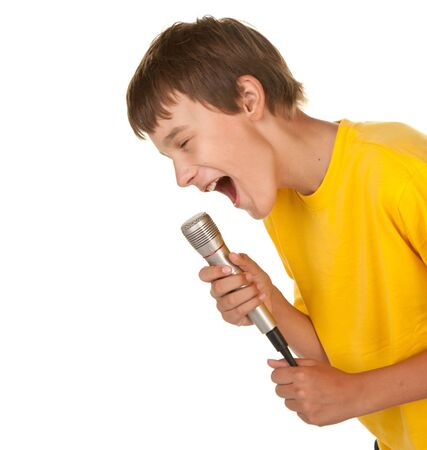 boy with a microphone doing karaoke on white photo