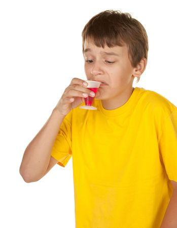 boy has to drink the really disgusting red cherry medicine photo