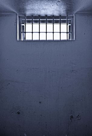 barred: old dirty prison cell with barred window noise added for effect