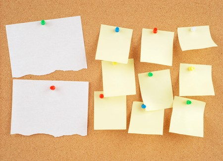 posted: great image of notes pinned to a corkboard Stock Photo