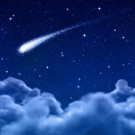 comet: comet or shooting star in space or night sky through the clouds