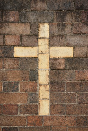 great image of a christian cross in a brick wall photo