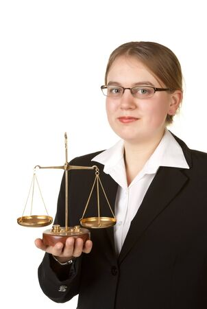 young female business lawyer with scales isolated on white background photo