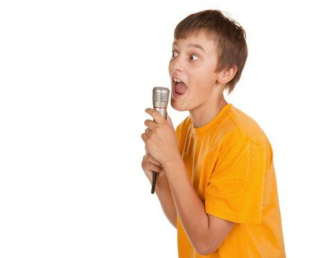 boy singing karaoke or talking on microphone looking at copyspace photo