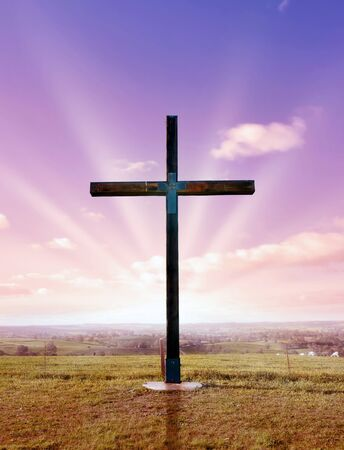 christian cross of christ at sunset or sunrise photo