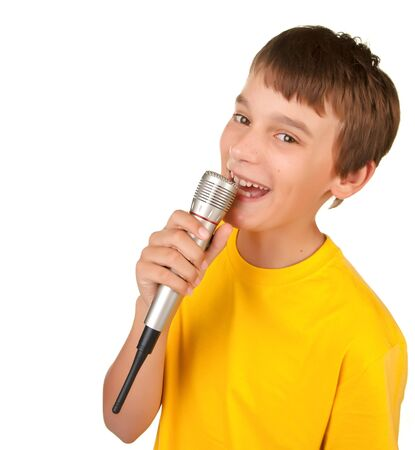 boy singing or speaking into microphone isolated white Stock Photo