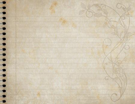 foglio a righe: immagine di un vecchio libro di carta foderato con disegno floreale