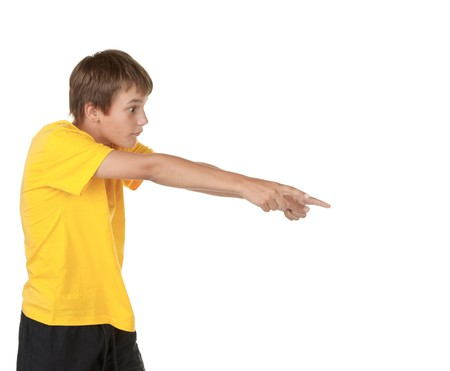 boy pointing to copyspace isolated on white photo
