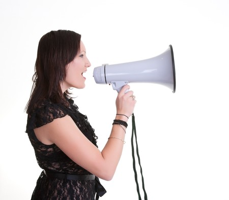 young woman with a megaphone or bullhorn isolated on white Stock Photo - 7828951