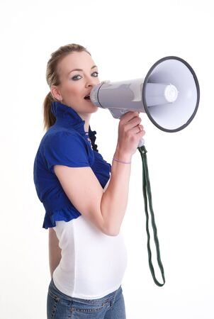 young woman with a megaphone or bullhorn isolated on white photo