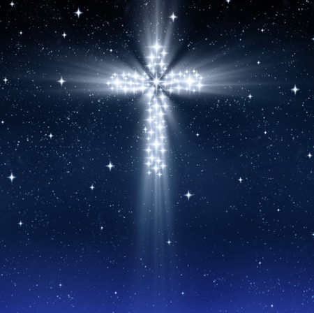 christmas cross: glowing christian cross in starry sky at christmas