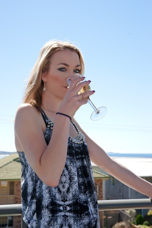 young woman with glass of wine in outdoors cafe or restaurant Stock Photo - 8379527