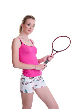 pretty young woman ready to play tennis isolated on white photo