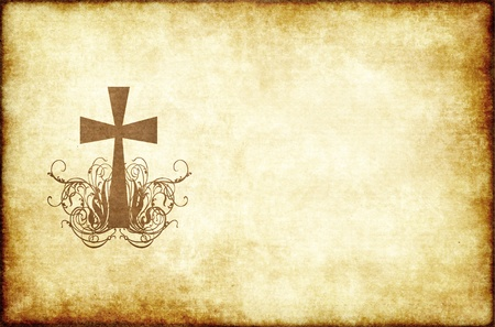christian cross on old and worn parchment paper photo