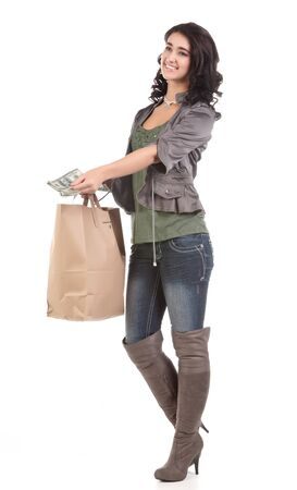 beautiful young teenage woman with shopping bag and cash photo