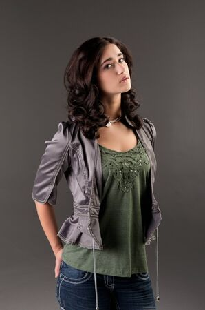 beuatiful young fashion teenager on dark gray photo