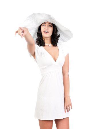 beautiful young fashion woman in white dress and hat pointing photo