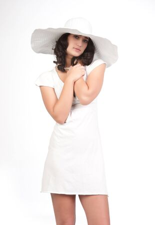 beautiful young fashion woman in white dress and hat photo