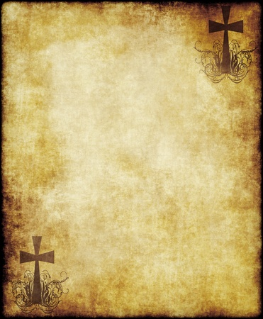 christian cross on old paper or parchment background texture photo