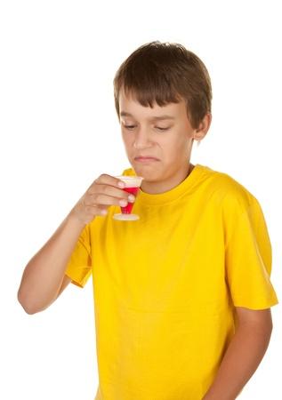 boy drinking medicine photo