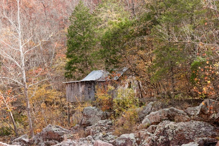 old settlers cabin in the forest in missouri photo