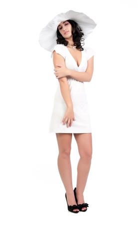 young woman in white dress and hat photo