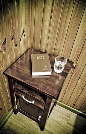 bedside: bible on bed side table Stock Photo