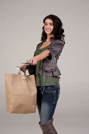 young woman with shopping and cash photo